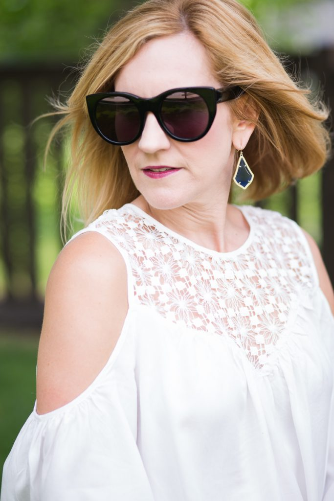 White crochet off the shoulder top with Kendra Scott earrings