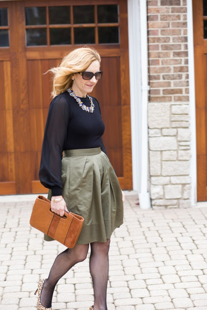 Thanksgiving look featuring a green skirt and sheer black blouse