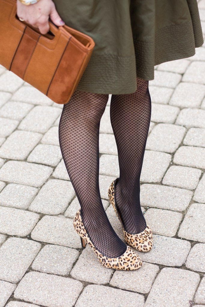 Leopard pumps with fishnets and tan clutch