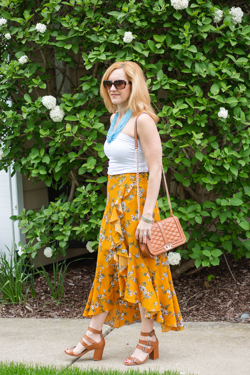 White Bandeau Top with a Floral Maxi Skirt and Blue Beaded Necklace