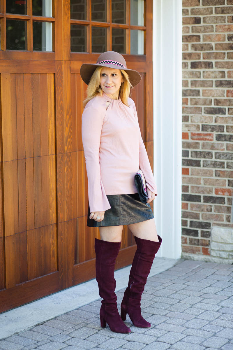 A sleek fall look featuring shades of pink mixed with black.