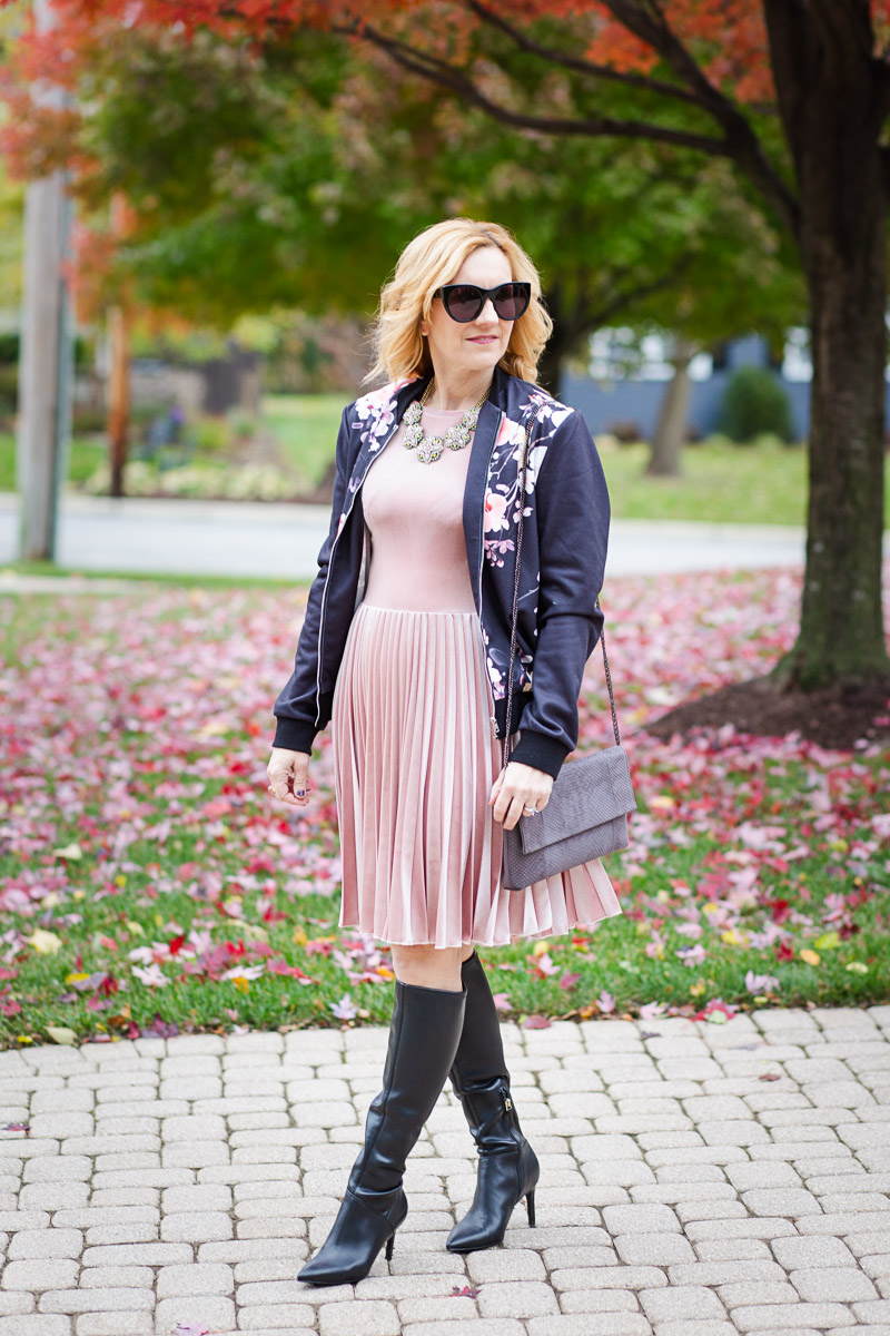 Black Floral Bomber paired with a pink velvet pleated dress and black leather knee boots.