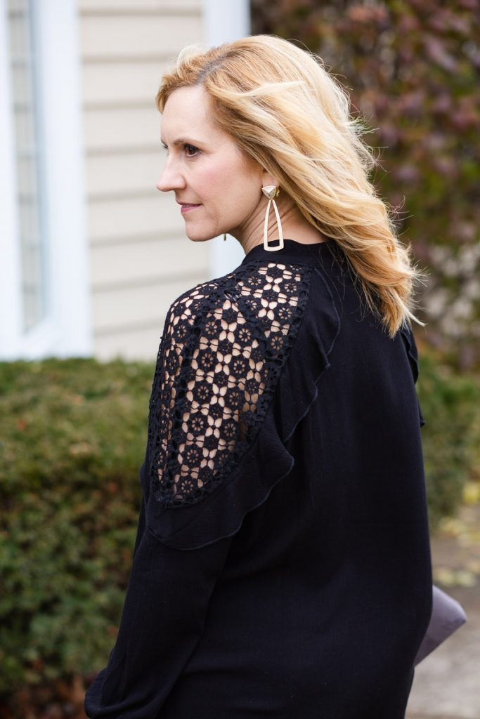 Black lace details of Tribal blouse from girl's night out holiday look.