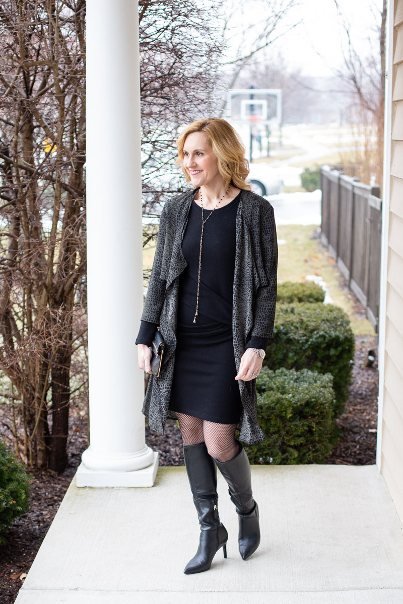 Layering over a little black dress with an animal print duster.