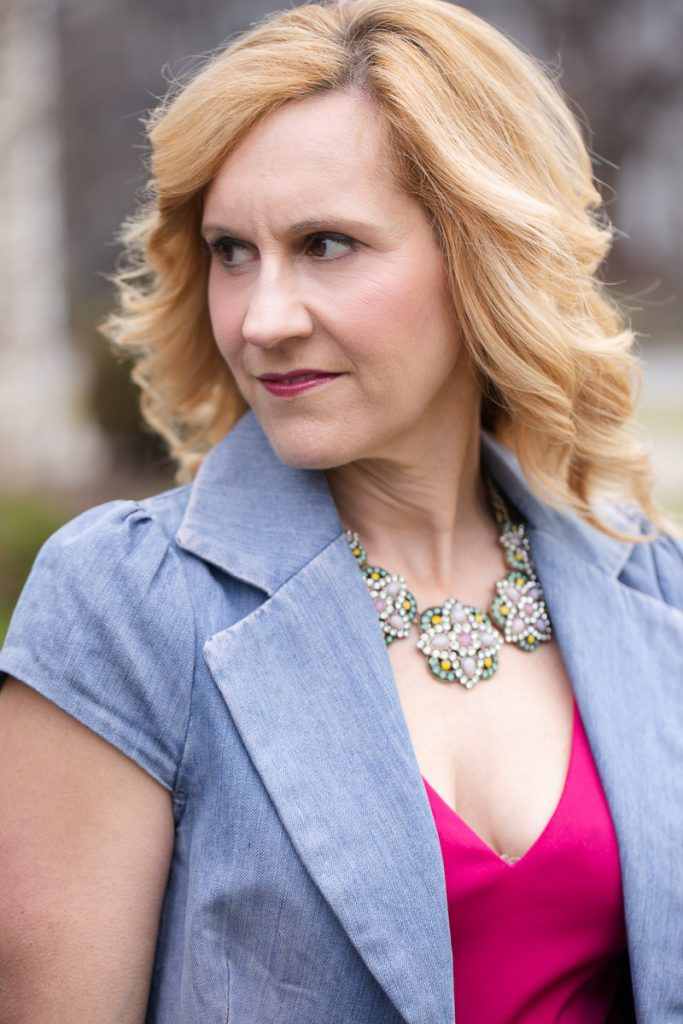 Adding a statement necklace and denim vest to my Easter Sunday dress.