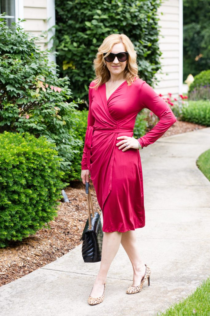 Styling a wine-colored wrap dress with leopard heels for a chic workwear look.