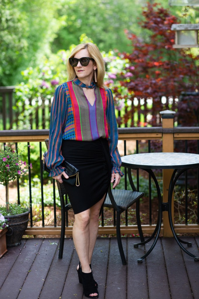 Edgy chic look for summer featuring a colorful peasant blouse from Antrhopologie.