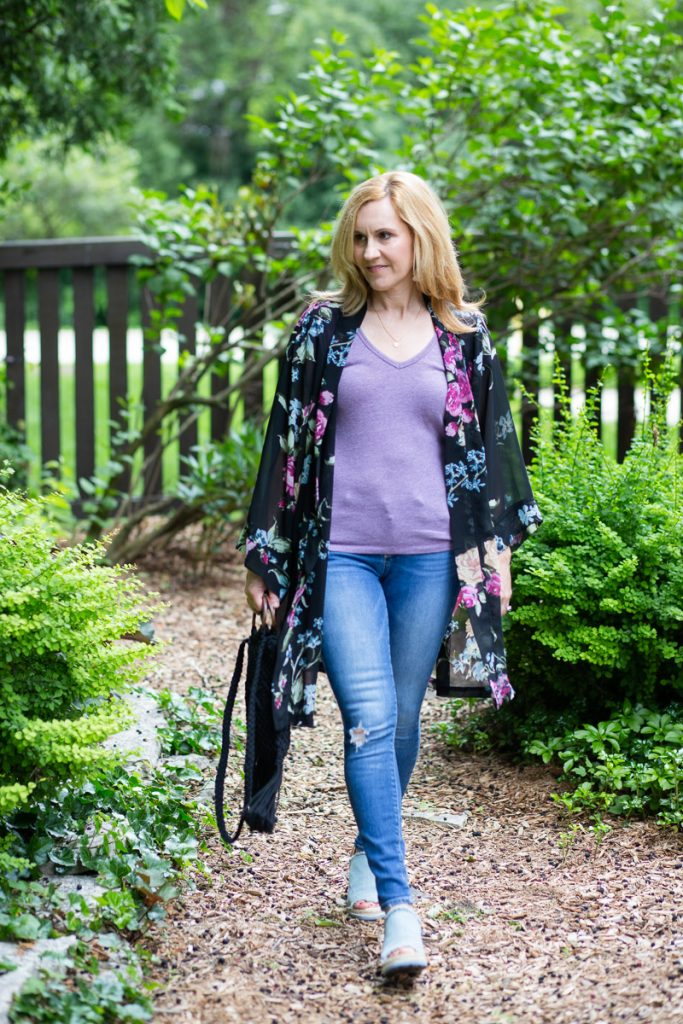 Wearing a floral kimono over a casual tee and skinny jeans.