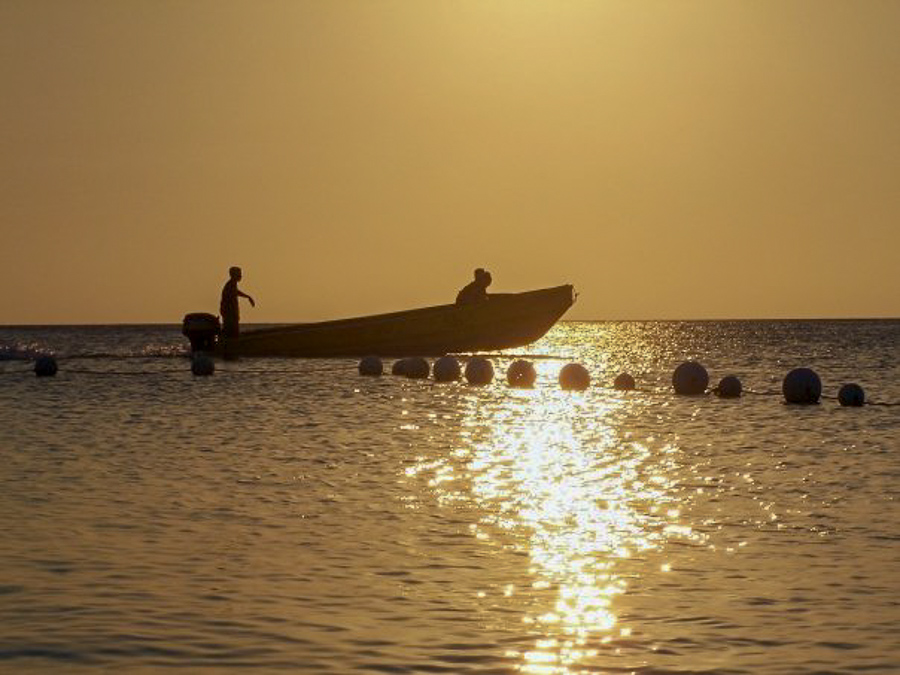 sunset at Henry Morgan Courtyard beach in West Bay in Roatan, Honduras