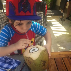 drinking a coconut in negril