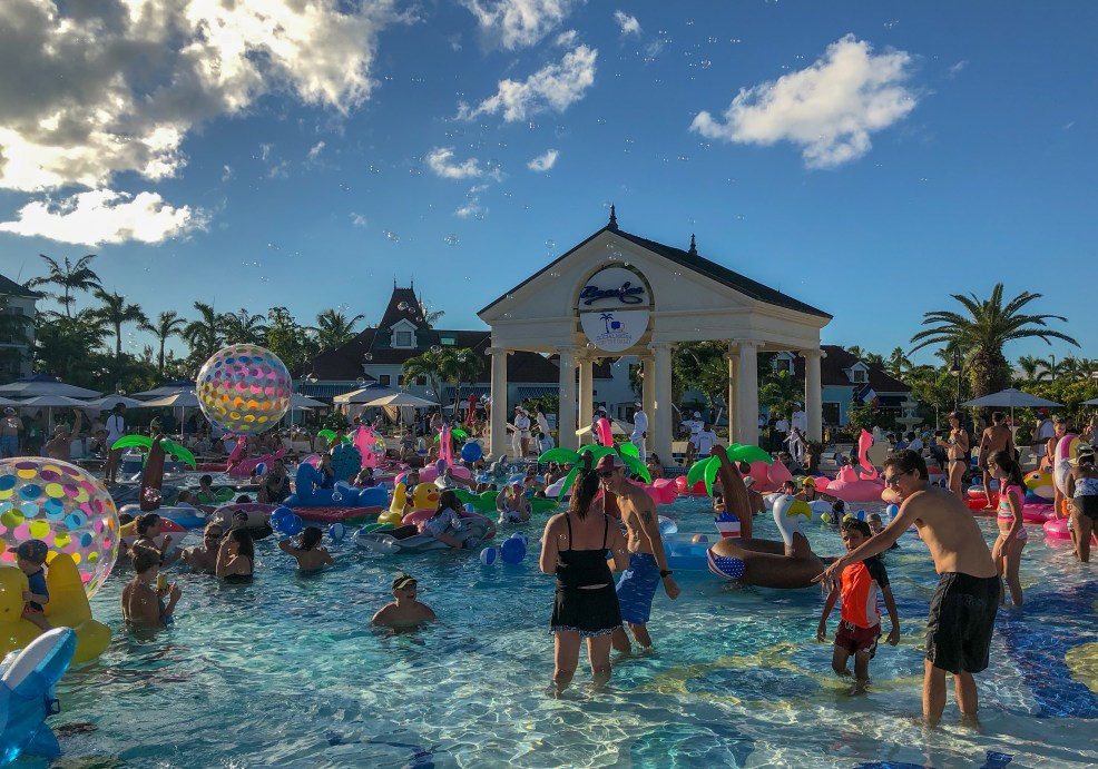 Epic pool party! Floatilia party in #FrenchVillage pool at Beaches Turks and Caicos Resort #beachesmoms #beachesturksandcaicos