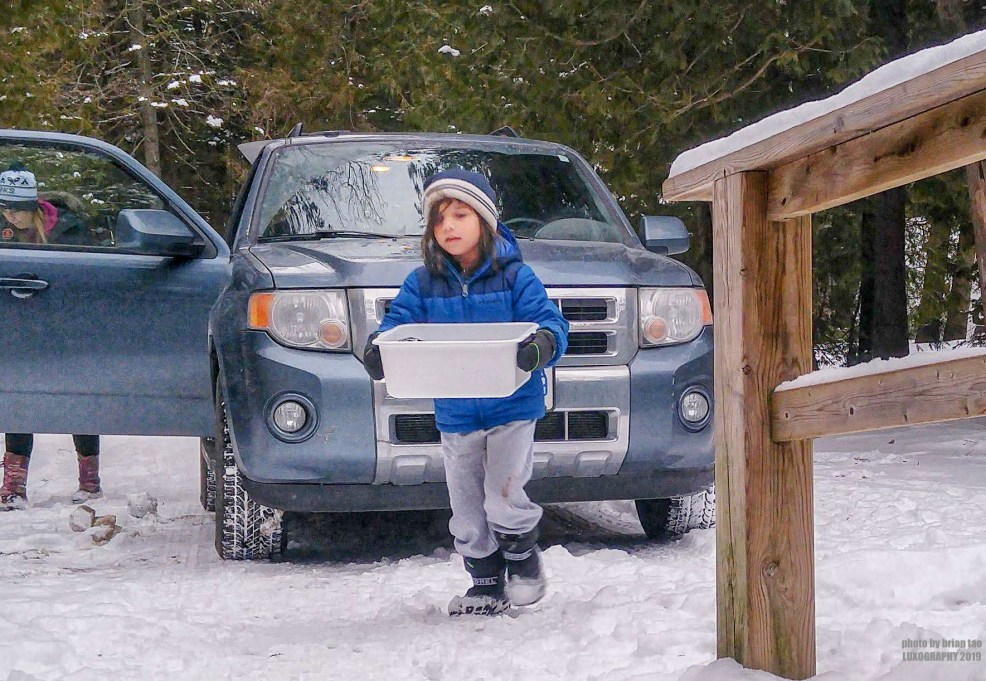 Little Man helping unload supplies from our Ford Escape for winter camping at MacGregor Point Provincial Park #findyourselfhere #macgregorpointprovincialpark #macgregorpoint #macgregorpp #ontarioparks #yurtcamping #wintercamping #outdoors #adventureparenting #portelgin #brucepeninsula PHOTO BY BRIAN TAO, LUXOGRAPHY 2019