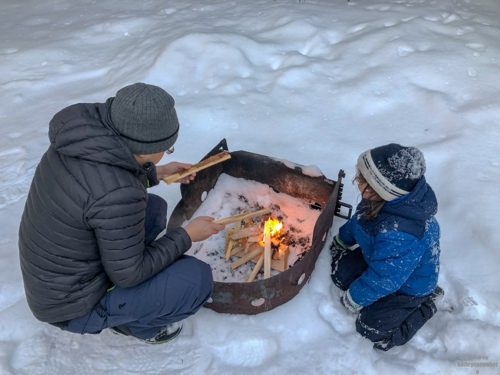Fire! Little man getting a lesson in building fires from Brian while winter camping at MacGregor Point Provincial Park in February! #findyourselfhere #macgregorpointprovincialpark #macgregorpoint #macgregorpp #ontarioparks #yurtcamping #wintercamping #outdoors #adventureparenting #portelgin #brucepeninsula #campcooking