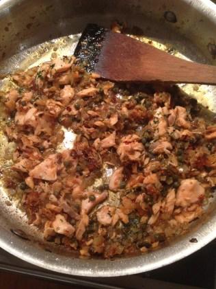 Adding the flaked salmon