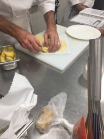 Chef demonstrates wrapping the curd