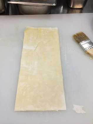 Fold in half again and brush with melted butter