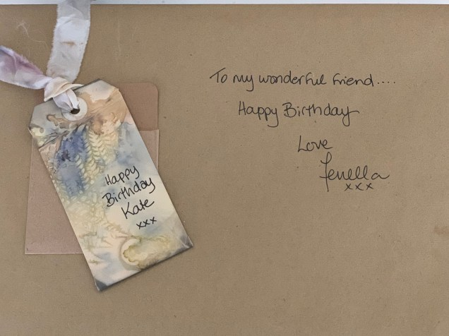 Beautiful hand dyed card and ribbon adorning my birthday gift.
