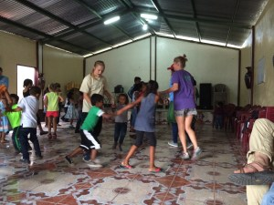 Dancing to the music with the kids.