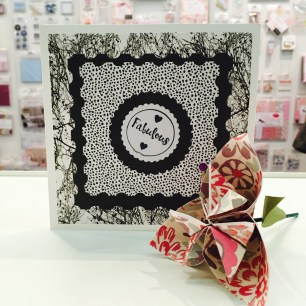Nesting stamp dies create frames on a handmade card using Black Out First Edition papers