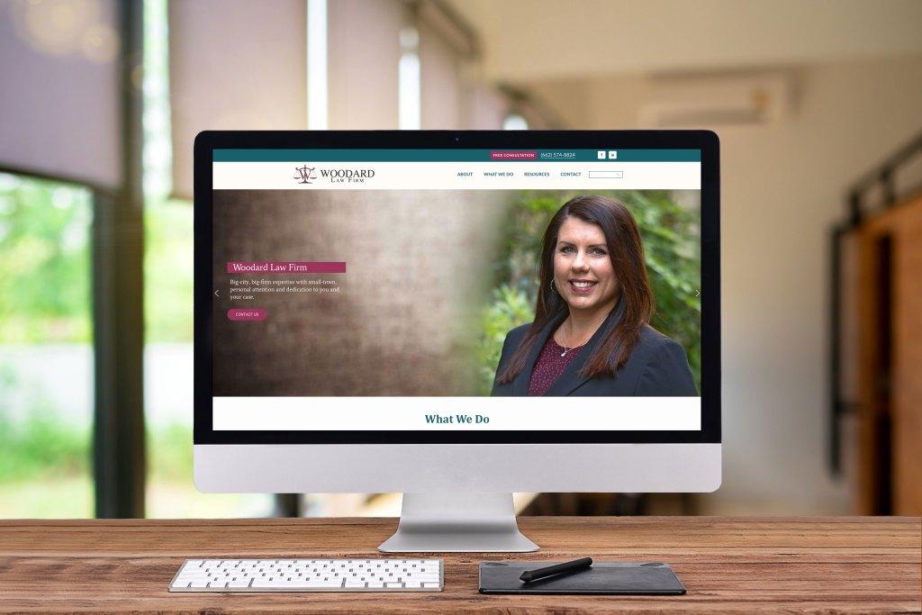 Desktop computer with Woodard Law Firm website showing