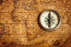 4233968-old-vintage-compass-on-ancient-map