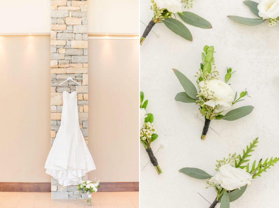 Wedding dress shot next to all white wedding boutonnieres