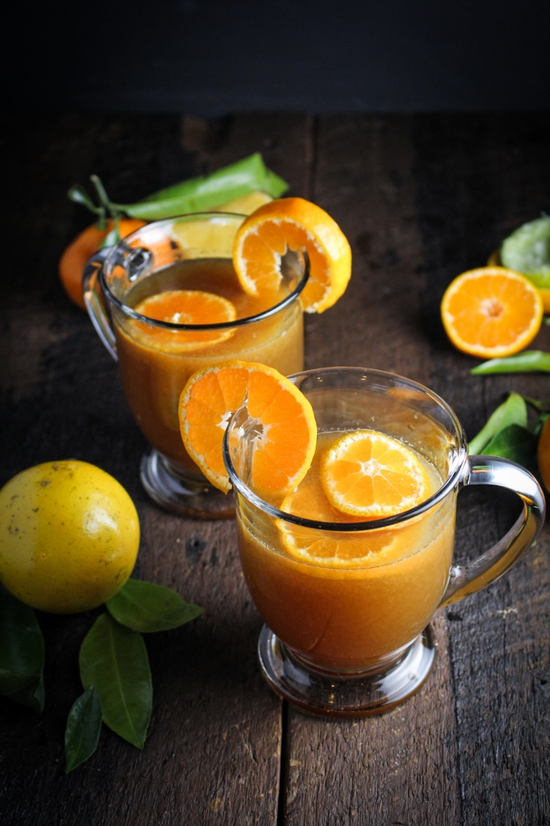 Ecuadorian Canelazo - Cinnamon Syrup, Citrus Juice, and Aguardiente, served warm {Katie at the Kitchen Door}