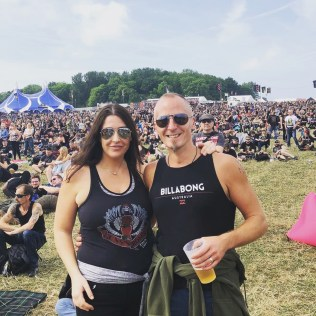 This is a photograph of Katie and her best friend Dale standing in the middle of Download Festival 2018 surrounded by the crowds.