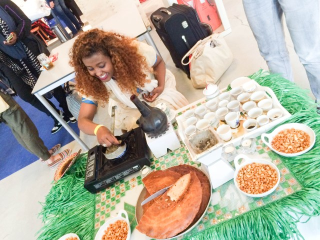 a volunteer demonstrating an Eritrean coffee ceremony during the Bed Talks hosted by The Student Hotel in Amsterdam
