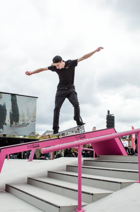 this skateboard grinds during a break in the freestyle session at the Amsterdam Skateboarding open competition in Museumplein