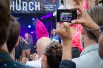 an excellent hairstyle on one of the photographers at the 2016 Drag Queen Olympics celebrating Gay Pride in Amsterdam