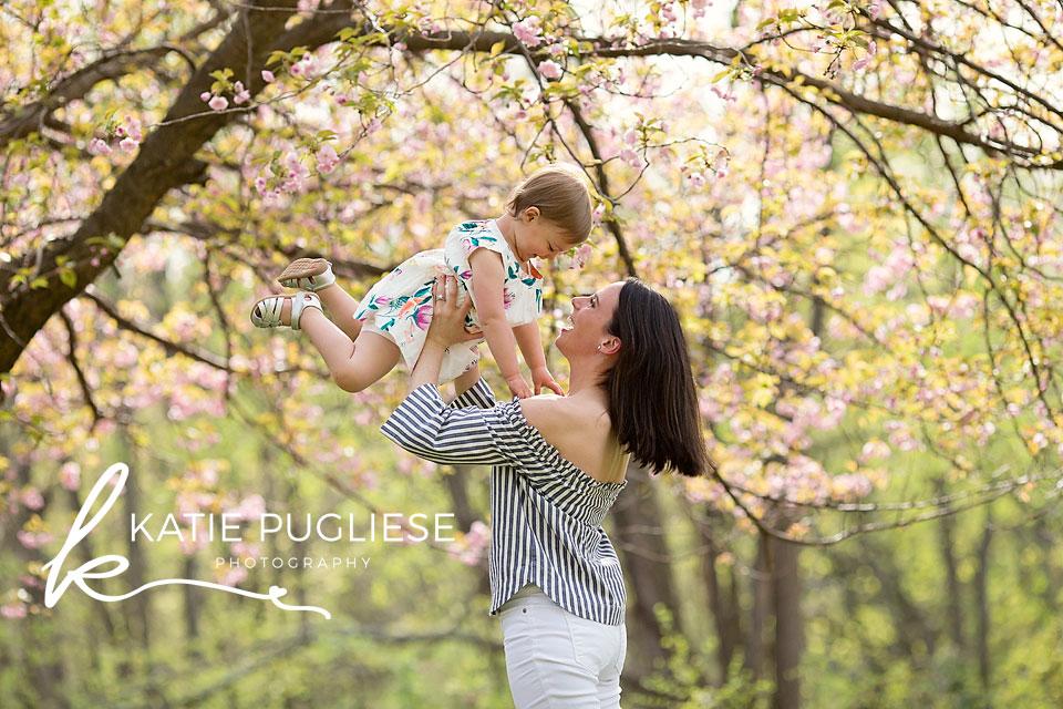 Mom lifting daughter in air