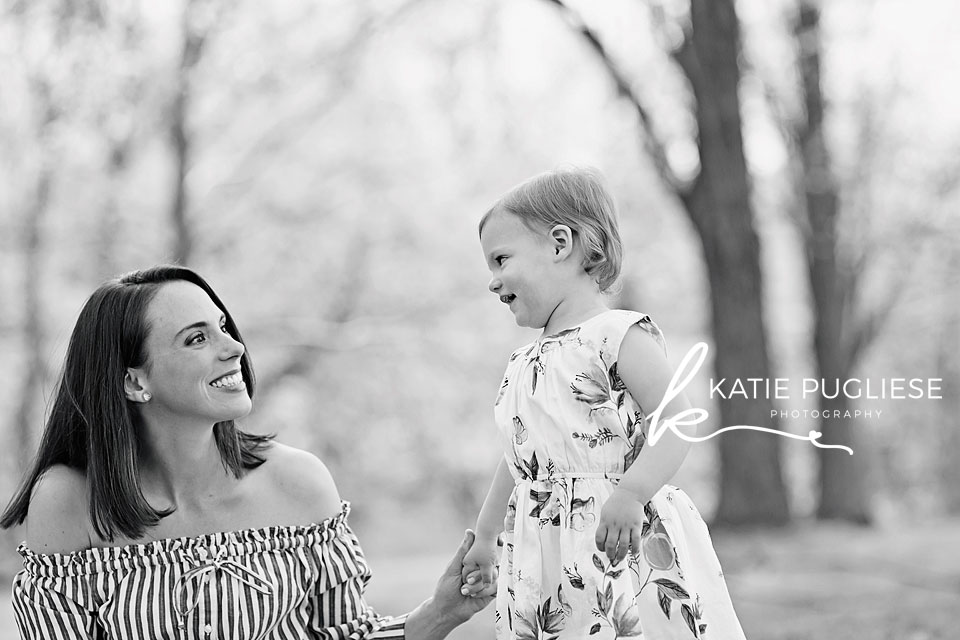 Mother and toddler daughter laughing