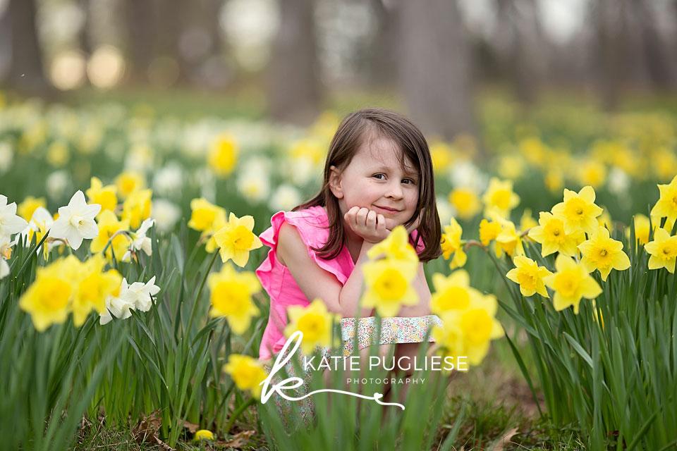 Toddler girl in daffodil field