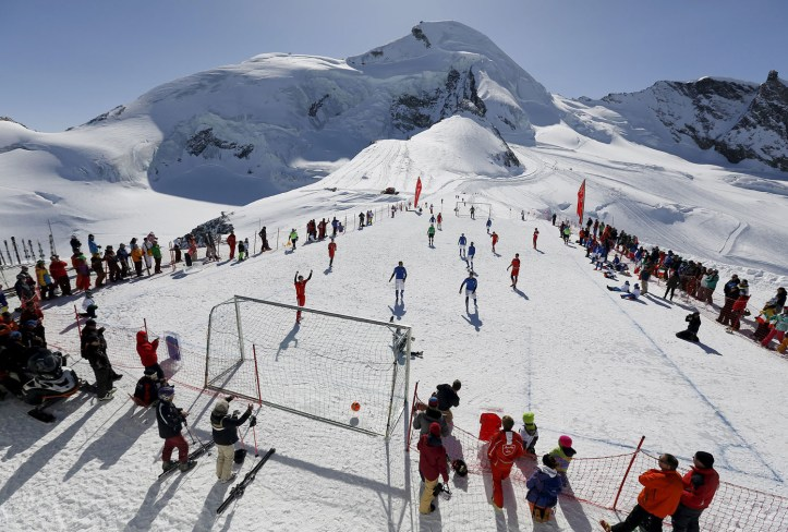 Amateur soccer players from Switzerland play against Italy during the Euro 2016 of the Mountain Villages soccer tournament on the Allalin glacier in Saas-Fee