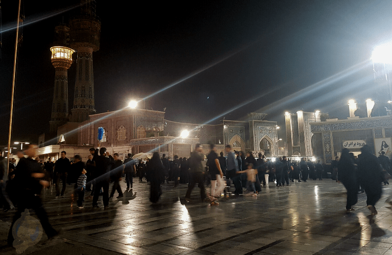 Pilgrims waiting to enter the Imam Reza complex