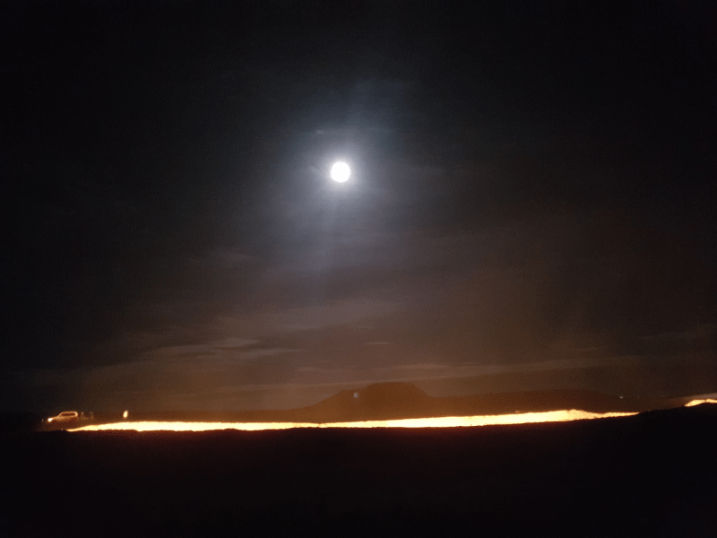 Moon over the Darvaza Gas Crater