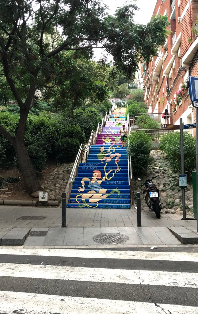 An outdoor staircase of over 150 steps, with the risers of each step painted in a colorful mural