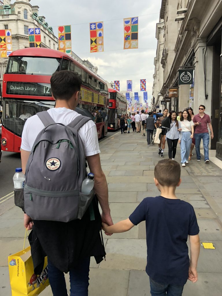 My husband and son walking in London.