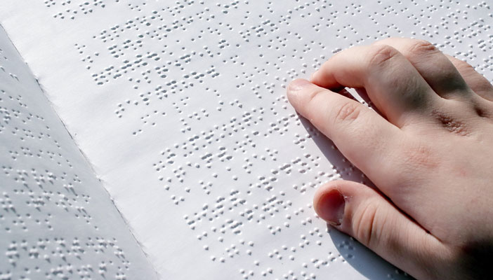Braille in use by a person