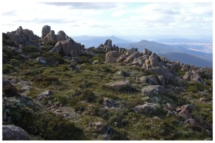 The rocky top of Mount Wellington. It was t-shirt weather down in Hobart but it was heavy Winter coat weather on top of the mountain.