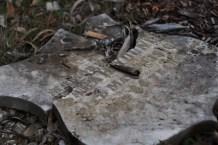 A sad, broken headstone.