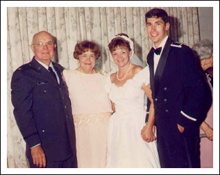 Cathy and her husband on their wedding day, with Cathy's grandparents
