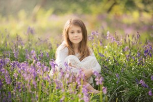Spring Wood Whalley - Girl in a white dress sitting amongst bluebells