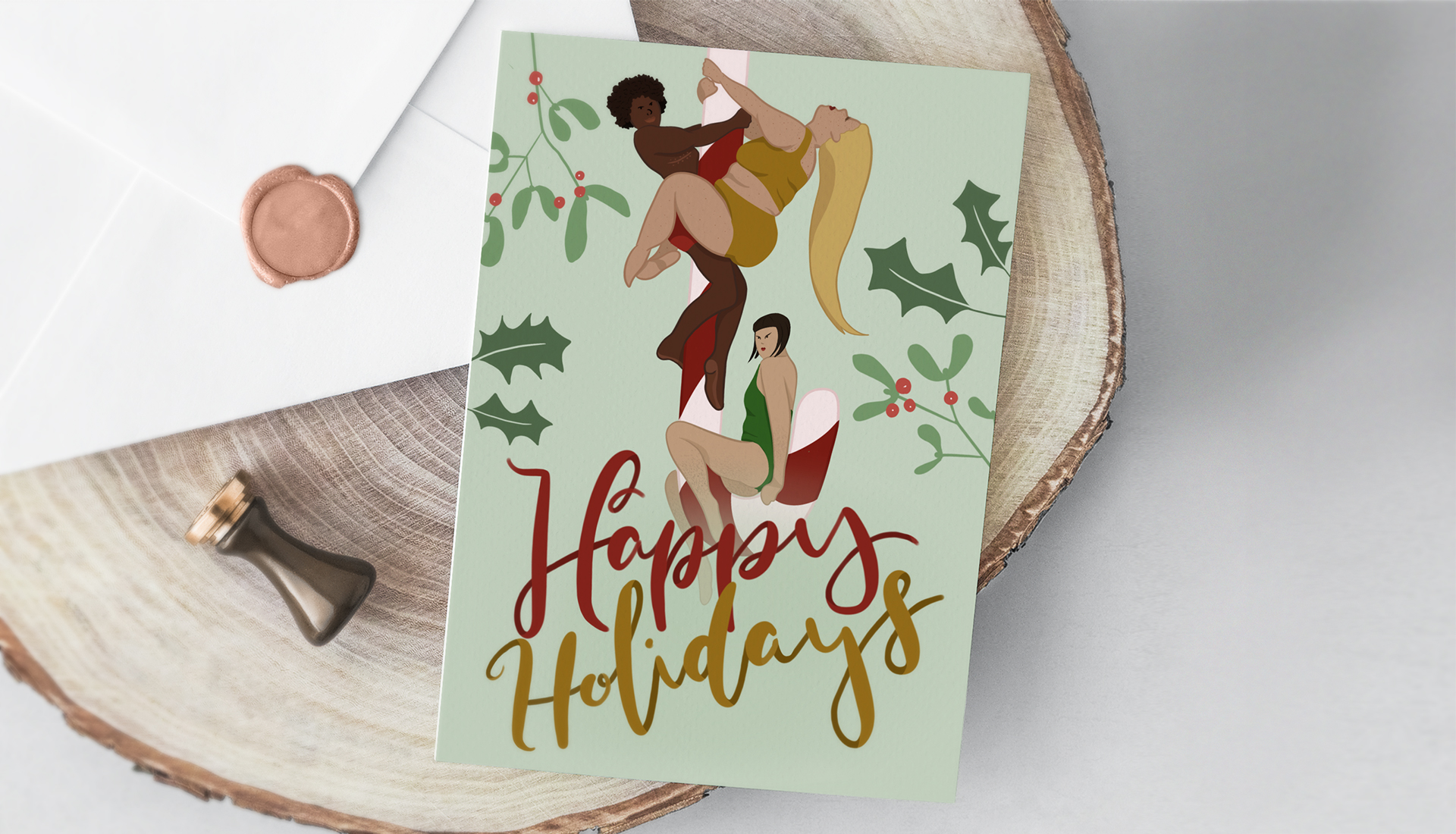 Christmas card with envelope laying on a wooden plate