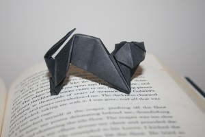Origami black cat standing on open book. katsilver.com