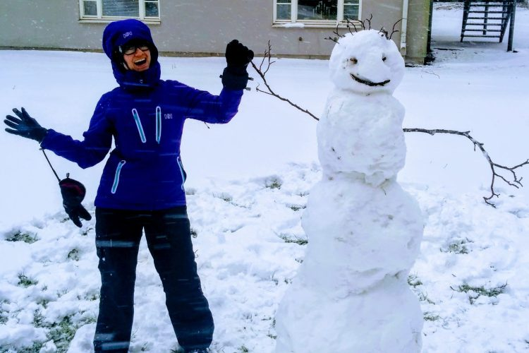 female posing with snowman