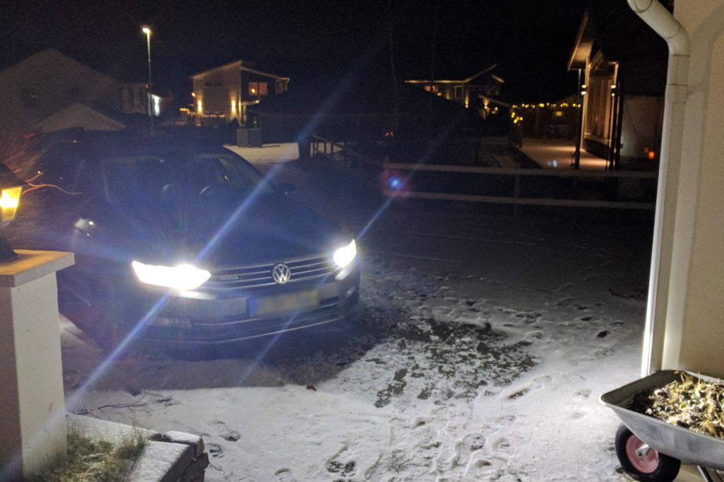 middle of the night with car headlights shining on snow