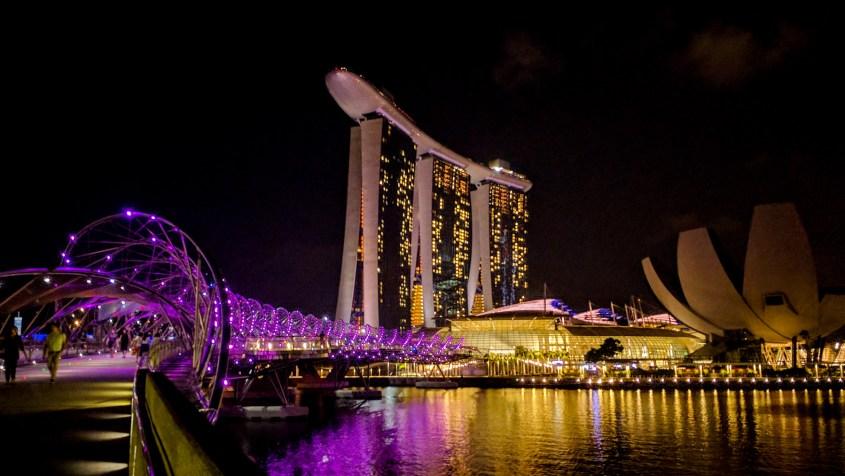bridge and hotel lit up at night