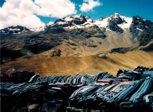 Peruvian blankets for sale with the Andes Mountains in the background.